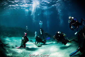 Divers decompressing at 3M stop after deep dive on SS Pre... by Mark Carter